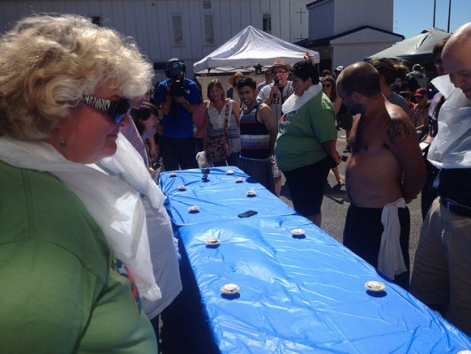 Participants wait for the start of the adult pie eating contest. Eric Reimer won.