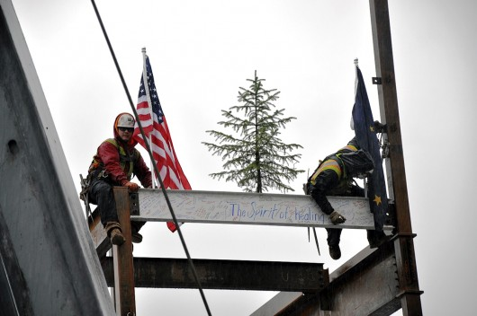 Construction crew members sign the final I-beam for the PeaceHealth Ketchikan Medical Center four-story addition. (Photo courtesy PeaceHealth)