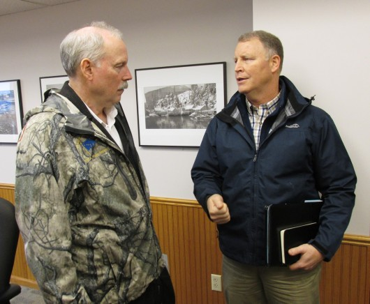 Sen. Bert Stedman, R-Sitka, and Alaska DOT Commissioner Marc Luiken talk at Ketchikan City Hall on Thursday. (Photo by Leila Kheiry)