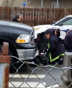 Paramedics respond to an accident on Tongass Avenue. A woman in a scooter was struck by a vehicle. (KRBD photo by Deb Turnbull)
