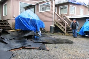 Roofing material is seen in the yard in front of Frank and Marge James' rented home off North Tongass Highway. The roof blew off in the storm earlier this week. (Photo by Leila Kheiry)