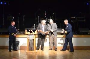 Commander Jack Jackson, Council Member Bob Sivertsen, Mayor Dave Landis and Admiral Daniel Abel officially mark Ketchikan as a Coast Guard City.