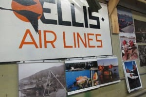 Historic signs and photos on the walls of the Goose hangar.