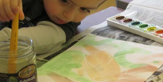 Nolan intently examines his creation.