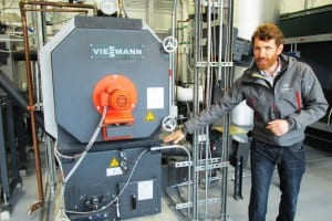 Andrew Haden of Wisewood, Inc., a Portland-based design firm, explains how the Ketchikan Airport's biomass boiler works. (Photo by Leila Kheiry)