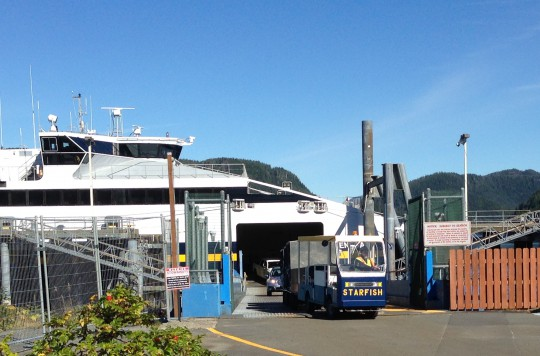 A baggage cart, nicknamed Starfish, leaves the Chenega in Sitka Sept. 3, 2015. The fast ferry is tied up for the rest of this fiscal year. (Photo by Ed Schoenfeld/CoastAlaska News)
