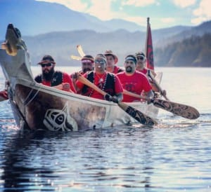 Klawock's Heinyaa Kwaan canoe crew paddling into Kasaan for Rededication of the Whalehouse; Lawrence Armour, Robert Jackson, Jonathan Rowan, Ronnie Fairbanks, Leslie Isaacs and John Smith (copyrighted photo by Marijane Armour used by permission).