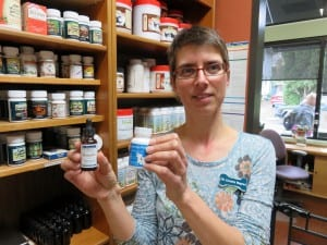 Dr. Cornelia Wagner shows several hemp-based supplements for pets stocked by the Hawthorne Veterinary Clinic. (NNN photo by Tom Banse)