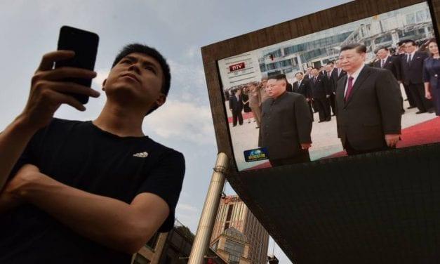 China's Xi Visits Kim In Pyongyang, With An Eye Toward Talks With Trump
